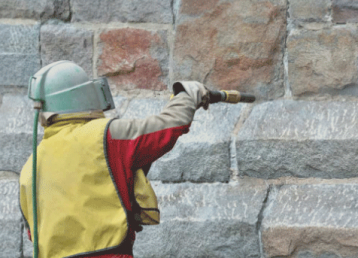 soda-blasting-orlando florida-concrete-wall-with-suit